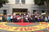 A large crowd of disabled, fat and elder protesters in front of the ICE building in San Francisco. Photo by Leslie Mah